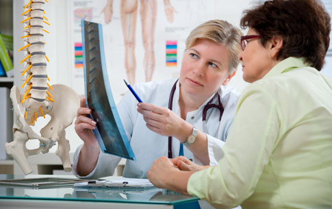 Doctor reviewing x-rays with patient